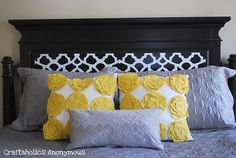 This is a tutorial for a headboard makeover, but I really want to know ow to make the cute yellow flower pillows!
