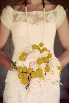 I love her bouquet. I don't know what the yellow flowers are, but I love them.