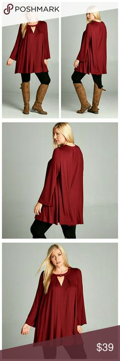 Burgundy Top With V-Keyhole Neck Burgundy top in a soft jersey with a lot of swing. Sleeves have a slight bell, and neckline is a v-keyhole with a functional button. Fabric is solid but lightweight, you might need a cami. EVIEcarche Tops
