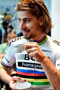 Slovakia's Peter Sagan drinks a coffee at a bike store prior to giving a press conference in Dusseldorf Germany on June 29 two days before the start. The Great Race, Olympic Sports, Bike Rider, Hot Guys, Hot Men, Pro Cycling, Olympics, Dusseldorf Germany, Champion
