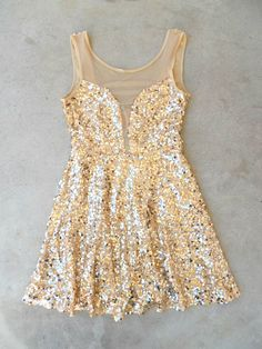 A plethora of sequins cascade over this gorgeous party dress. Frock features an illusion neckline paired with a skirt perfect for spinning. Hidden side zipper and fully lined. Polyester. Imported. Len