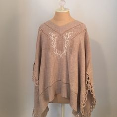 Cute cotton poncho! 100% poncho- great neutral color with white detail and loopy border trim. Worn only once- like new! Sized at Petite Small, but very generous. Open sides, slips on over head. Willi Smith Sweaters Shrugs & Ponchos