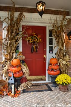 Load your porch with an abundance of seasonal flair. Make sure your decor is symmetrical on either side of the door to keep the space from becoming too busy.