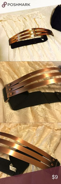 Authentic Metal Bronze Stretch Belt Snap Button Must have belt! True metal. Bronze color. So sexy!! You will get so so so many compliments on this belt!! Snap closure. Stretch belt. Size large. Bundle and save!! Make me a bundle offer!! Xoxo Deena & Ozzy Accessories Belts