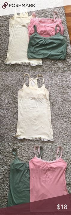 Abercrombie tank tops Selling all 3 Abercrombie tank tops. All 3 are size large and have built in bras.. The yellow top is a razor back with adjustable straps. No trades Abercrombie & Fitch Tops Tank Tops