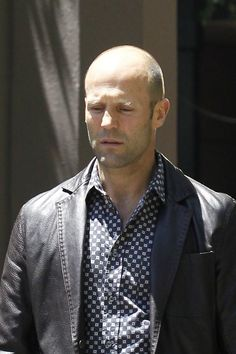 Jason Statham walks to the set of his latest action drama 'Heat,' being filmed in New Orleans.