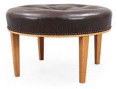 A Josef Frank mahogany and brown leather stool by Svenskt Tenn.