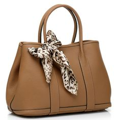 Camel Colored Leather Bag with a Leopard Tie on the Handle.