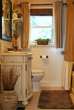 Vintage Home Decor Ideas - Love the creamy antique finish on the vanity with the black mirror, neutral floor, natural elements and white beadboard. Very appealing. Big Bathrooms, Bathroom Renos, Beautiful Bathrooms, Rustic Bathrooms, Bathroom Ideas, Primitive Bathrooms, Design Bathroom, Bathroom Interior, Bathroom Layout