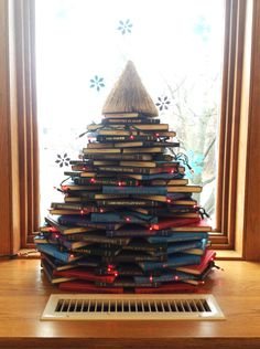 Want a Christmas tree in your bedroom/dorm room but your space is too small? Make a tree out of your favorite books! (Let's see someone do that with a Kindle.) #weloveprint #booklove #MerryChristmas