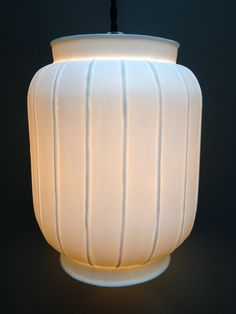 Porcelain lampshade by Alix D Reynis.