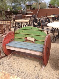 Bench made out of those wooden things they used to wrap electrical wire and cable around... so cute