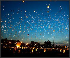 8000 floating lanterns released into the sky in Poznan, Poland (in celebration of the Summer Solstice.)