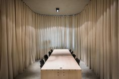 slovenian office by dekleva gregorič arhitekti can be divided with retractable curtains