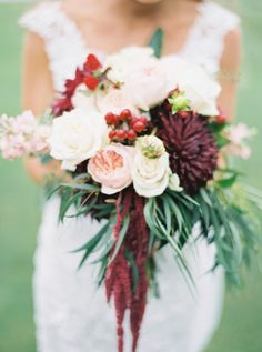 Pretty burgundy and berry hued bouquet: http://www.stylemepretty.com/2016/07/14/forget-catching-pokemon-catch-these-wedding-bouquets-instead/