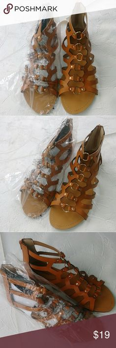 12 M Ashley Stewart gladiator sandals caramel gold 12 M Ashley Stewart gladiator sandals caramel gold Smoke-free and Pet-free home All items are up to my standards No rips or holes  No peaking No Stains All reasonable offers will be accepted Ashley Stewart Shoes Sandals
