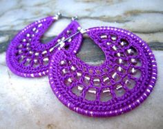 Crocheted hoops with beads in magenta