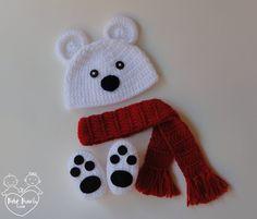 """Conjunto Ursinho Polar composto por: Touca, sapatinhos e cachecol em crochê.    Faixa de tamanhos (circunferência):    RN (34-36cm)    1-3 meses (38-40cm)    3-6 meses (42-44cm)    ATENÇÃO: - Por favor, informe o tamanho desejado do produto em """"Contatar vendedor"""" durante a compra;    - O prazo de..."""