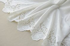 White cotton embroidery curtain fabric ,skirt cotton lace fabric Color: white (The real color may be slightly different from the pictures shown on