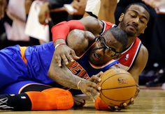Amare staying tough on the ball while J Wall tries to get a jump ball.