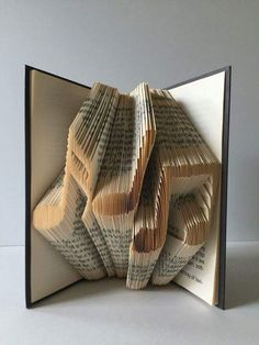 50 Book fold 50 sculpture Folded book art Paper anniversary 50 year old Party decoration Table centerpiece Birthday Gift Origami book art