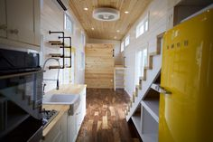A big and beautiful tiny house by Nomad Tiny Homes of Dripping Springs, Texas. The 357 sq ft home was designed for a family of five. Love the pops of yellow in the house.