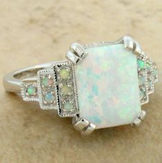 Lovely White Opal Art Deco Ring – I love the idea of opals instead of diamonds, at least for the center stone