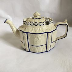 A beautiful English Castleford teapot in perfect condition c Elliptical body moulded in low relief with classical figures and acanthus leaves with blue outlined panels sliding lid. Teapots And Cups, Teacups, Traditional Teapots, Cedar Creek, Ceramic Teapots, Kettles, Coffee Set, Antique China, Tea Sets