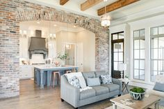 Explore our new homes in the Lafayette, LA area through the Manuel Builders photo gallery. Brick Archway, Brick Columns, Brick Wall, Build Your Dream Home, My Dream Home, Dream Big, Dream Homes, Acadian Style Homes, Open Plan Kitchen Living Room