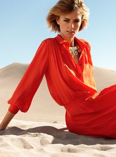 Who is brave enough to wear this poppy-orange dress???  Can I wear this instead of a wedding dress??!