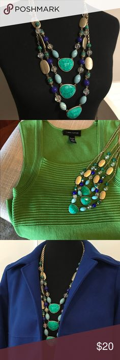 Gorgeous layer necklace - great with everything! Layer necklace with gold chain. Colors are greens, turquoise, blue and clear. Looks great layered over a blouse or for some color under a jacket! Saks Fifth Avenue Jewelry Necklaces