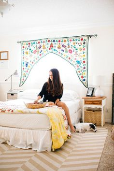 Love the curtain over the bed