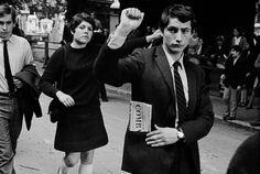 """Striker with """"Combat"""" in his pocket, famous left-wing newspaper founded by Philippe Tesson. Paris, May '68."""