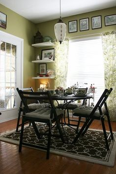love the green (Wasabi by Valspar), crisp white, and dark furniture. www.apartmenttherapy.com