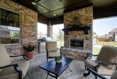 Outdoor living area with fireplace.