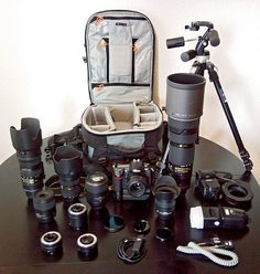 Wedding photography kit - 50mm lens, 24-70mm lens, speelight, mini softbox or diffuser, spare memory cards, spare batteries, and tripod