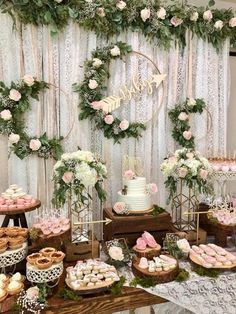 Rustic-chic baby shower dessert table - wooden and white metal displays for pies and cookies, white and pink flowers with greenery, and gold geometric accents. Briar Barn Inn, an inn and restaurant north of Boston, Massachusetts. BriarBarnInn.com