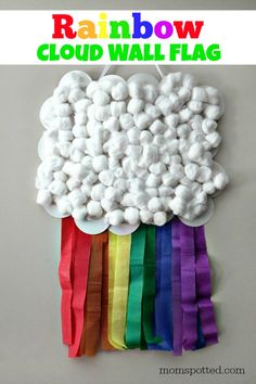 This colorful kids craft is perfect for St. Patrick's Day craft or as a rainbow cloud wall flag for a birthday party. Fun craft for all ages!
