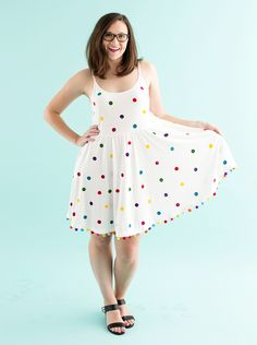 You can make a colorful polka dot pom pom dress for the summer by following this easy DIY sewing project.