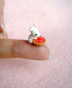 Tiny bunny on a strawberry cake.