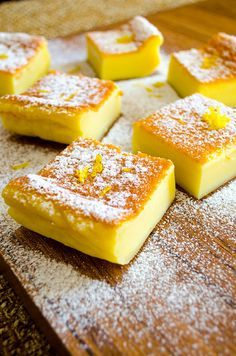 A very light zesty magic custard cake. This could be your ultimate sweet treat to impress your guests. The batter is really runny, so don't get confused. It gets thicker as it is cooked. Köstliche Desserts, Delicious Desserts, Yummy Food, Baking Recipes, Cake Recipes, Dessert Recipes, Baking Pan, Magic Custard Cake, Light Cakes