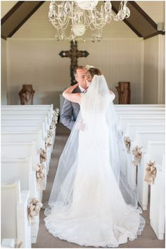 Bride and groom kiss inside Little White Chapel of Twisted Ranch; Texas Ranch Wedding Photographer