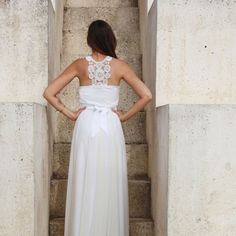 This simple and romantic chiffon dress features a crocheted lace racerback and panel neckline. It's a steal at $350!