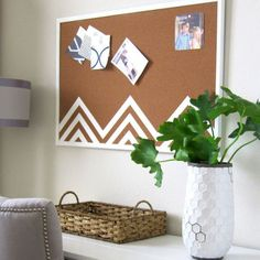 """Cork memo boards ensure our to-dos get """"to-done,"""" but they don't have to look utilitarian to work. A few lines of white paint adds unexpected flair to this piece. Click through for a tutorial and more ways to make your home organizers look prettier."""