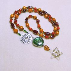 Silver Star Necklace, Baltic Amber, art glass, porcelain, art pendant, fall colors by ArizonaBeadWorks on Etsy This beautiful Fall/Holiday necklace can be worn long or doubled around the neck. Gorgeous art glass pendant.