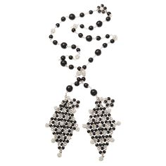 Chanel bead and crystal sautoir  France  1980s  A stylish long bead and crystal sautoir with floral accents loops around the neck