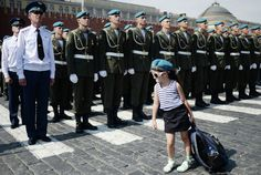A young girl inspecting Paratroopers on parade in Red Square