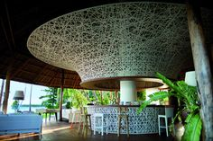 Dedon Island - A circular bar filled with eclectic furniture