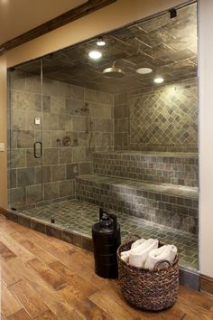 Beautiful combination steam room, sauna & shower. Love the warm wood floor in contrast to the stone tile ... We really like this shower at www.bathroom-paint.net!
