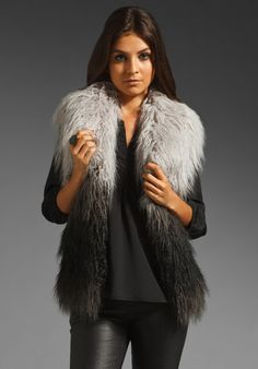 """""""Faux or no"""" by aliology.com. Depending on how you use these materials, they can be lush and lux, natural and warm, or fun and flirty. With only one exception, I have collected my favorite faux pieces – from natural-looking faux furs to a silk-blend feather skirt to shag yarn jackets. (Yes, I said shag yarn.) { Mongolian Faux Fur Vest by Graham & Spencer }"""